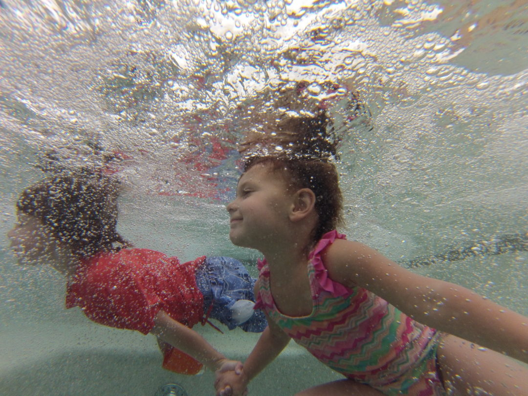 Kids having fun and playing after their swim lessons.