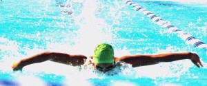 Adult advanced swimmer practicing her butterfly stroke.