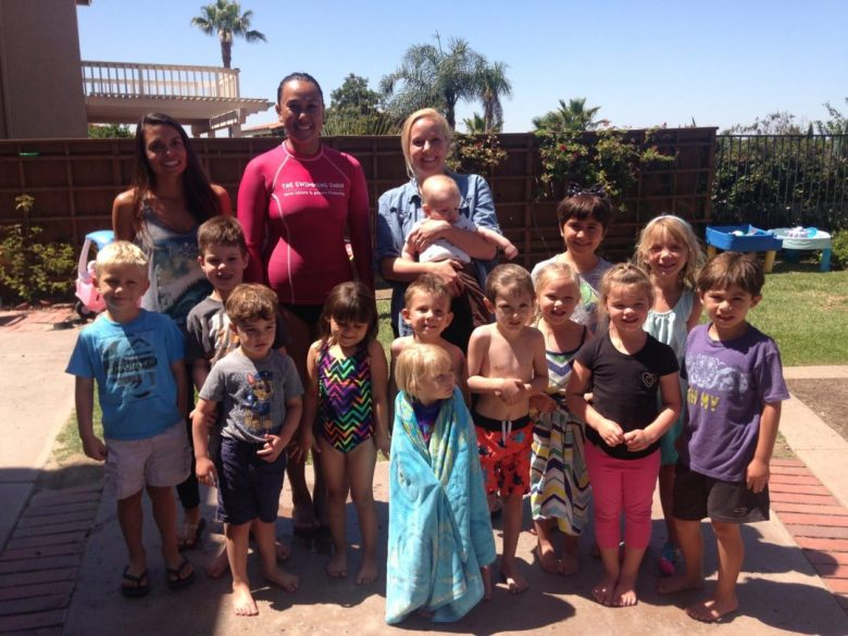 All the kids smiling in our day care swimming lessons with instructor Jane