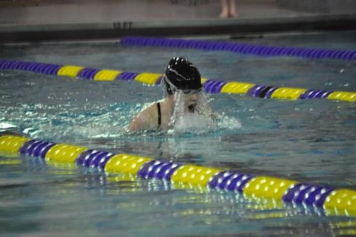 Female breaststroker perfecting her stroke.