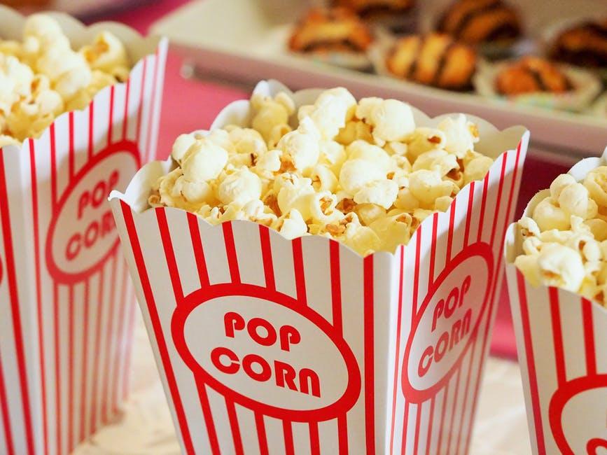 Family movie fun eating popcorn