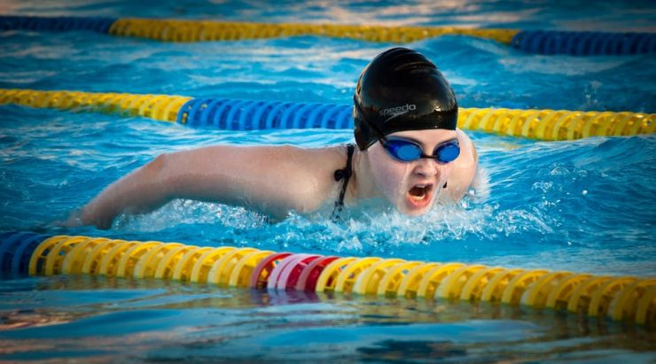 Adult swimming butterfly stroke
