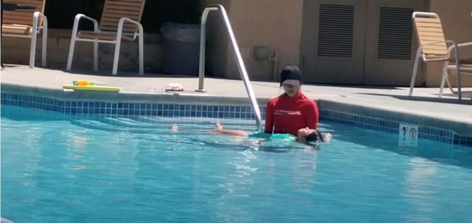 Swim instructor teaching back floats on employment page