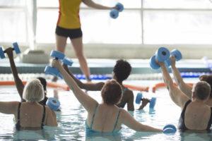 Leading a water aerobics class