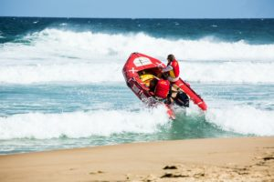lifeguard beach rescue with raft